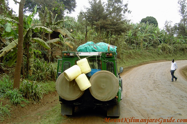 Unsealed road to Machame Gate