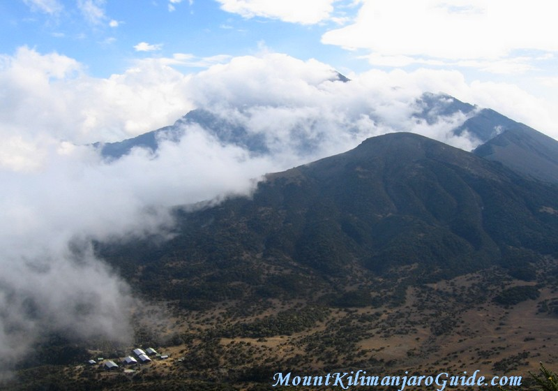 The cloud filled crater of Mt. Meru, with the Saddle Huts in the bottom left corner.